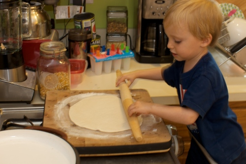 Arlo rolling out the dough