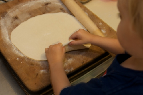 Arlo checks the thickness of the dough - looking for 3mm
