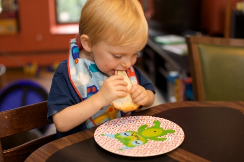 Arlo enjoys the fruits (pie) of his labor